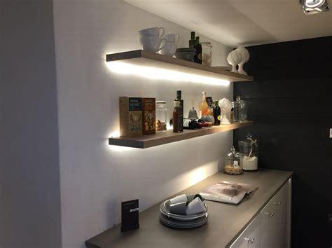 Shelf Lighting by Floating Shelves With Led Lighting On Exposed Brick