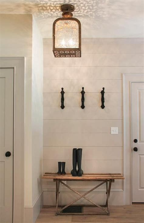 Shiplap Wall Hanging by Cottage Foyer With Gray Shiplap Siding And Lantern Light