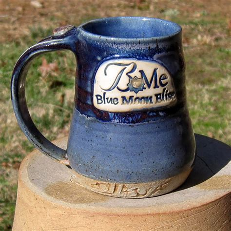 Deneen pottery footed mug came off the line in 1996 and has remained a customer favorite ever since. Logo Mugs | Smoke in the Mountains Pottery
