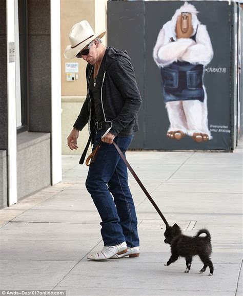 mickey rourke finds  tiny  puppy  loss