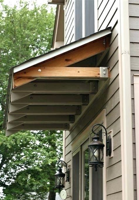 windows awning ideas   dream house basement entrance porch roof front door awning