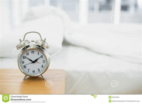bedroom alarm clock retro alarm clock standing on a bedside table stock images 10273