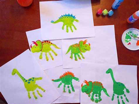 dinosaur handprints  images preschool crafts