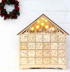 wooden led lit advent calendar by the forest & co