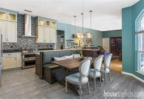 Kitchen island and attached banquette steal center stage