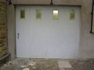 Installer une porte de garage coulissante for Porte de garage coulissante et double porte salon