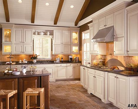 home and insurance pictures of cream colored kitchen cabinets