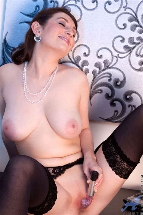 older lady with short hair toys her pussy in black stockings
