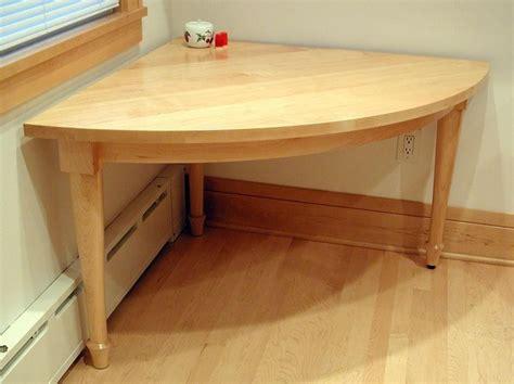hand   person quarter circle kitchen corner table