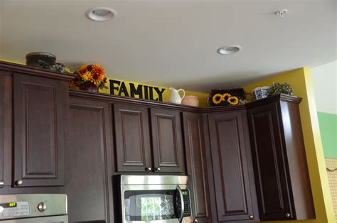 decorating ideas for top of kitchen cabinets ideas for decor on top of kitchen cabinets design7 9842