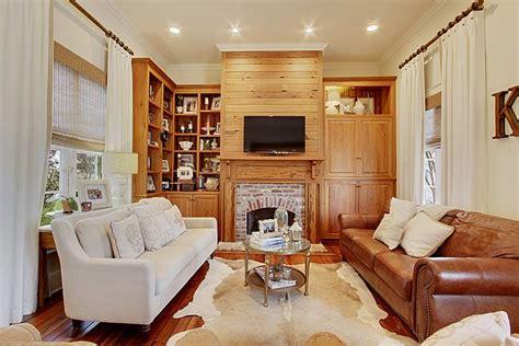 living room neutral colors cowhide rug linen panels