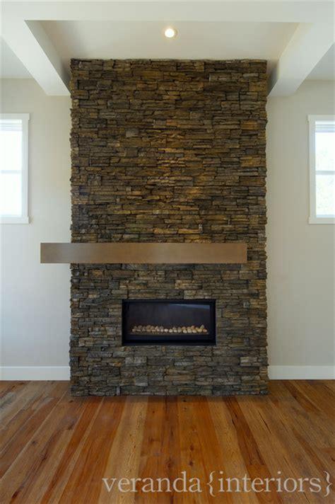 stone fireplace   set mantle contemporary living room calgary  veranda estate