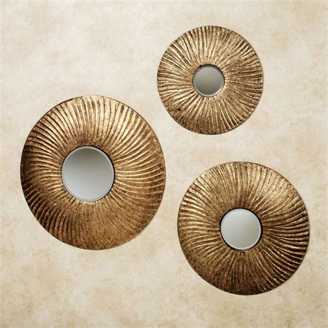 These three flower pieces are fun and timeless. Mason Round Mirrored Metal Wall Art Set