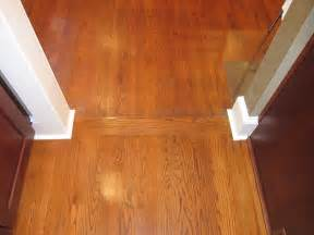 transition between wood floors and and hardwoods with a transition
