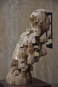 These Pixelated Sculptures That Look Like Computer Glitches Are Actually Made From Wood