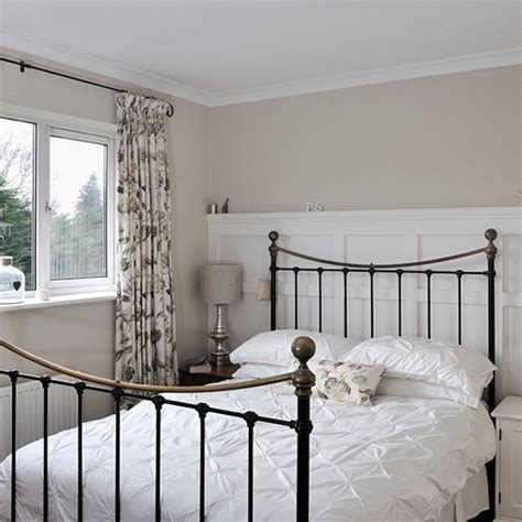 neutral bedroom with floral curtains traditional bedroom