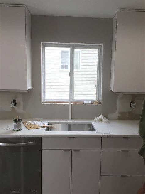 center kitchen faucet  window  sink  slightly