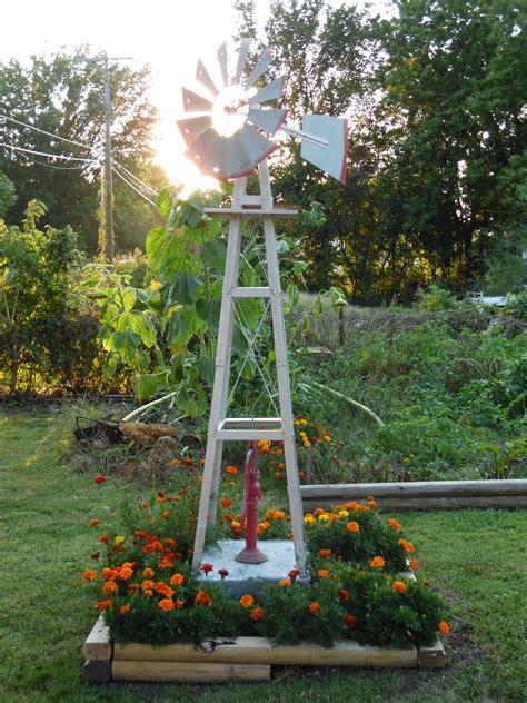 windmill bed backyard  flowers  beds garden
