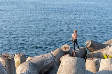 fishing pole breakwaters fisherman copy space