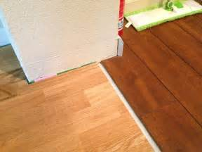 how to install baseboard at the transition between floors with different height home