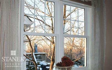 double hung windows  colonial grids   top sash   white interior color