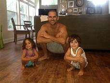 resting squat progression--man and 2 kids squatting