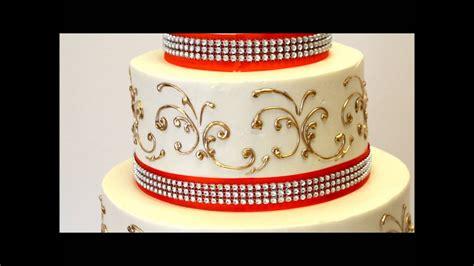 tier wedding cake  gold  orange ribbon