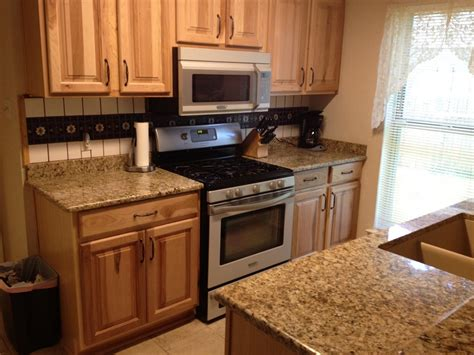granite countertops and cabinets honey oak cabinets with black granite countertops google