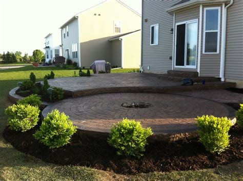 sted concrete patio two levels with a pit ring