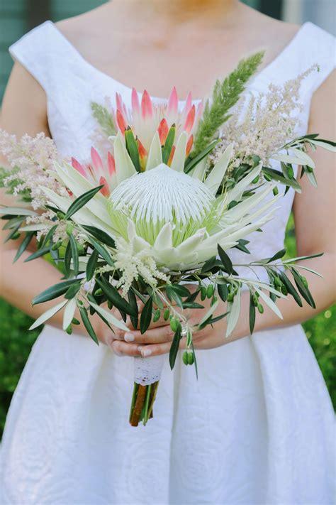 white  pink protea bridal bouquet