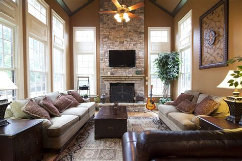 stunning vaulted keeping room  floor  ceiling stone fireplace  windsor green court