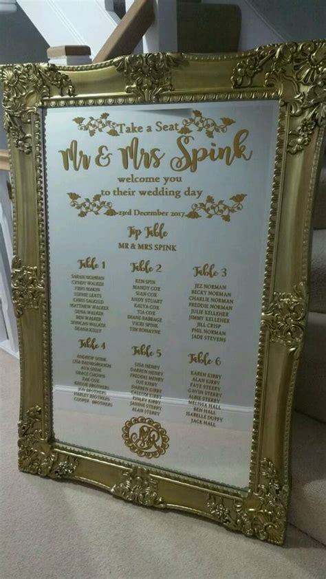 large gilded gold mirror wedding table seating plan