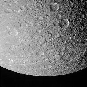 NASA probe makes last visit to Saturn's moon Dione ...