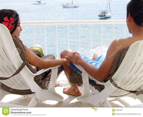 Couple Sitting In Lounge Chair Stock Image  Image 18227527