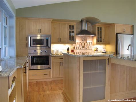 light wood cabinets kitchen kitchen with stainless steel appliances and light wood 7014