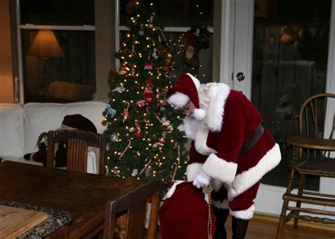 betty page under the christmas tree icaughtsanta announces new service to help parents catch santa on and in