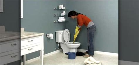 how to unclog a toilet how to properly unclog a toilet 171 construction repair wonderhowto