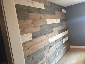 the requarth co supply one showroom With barnwood feature wall
