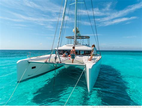 freedom luxury charter sailing catamaran guests bow
