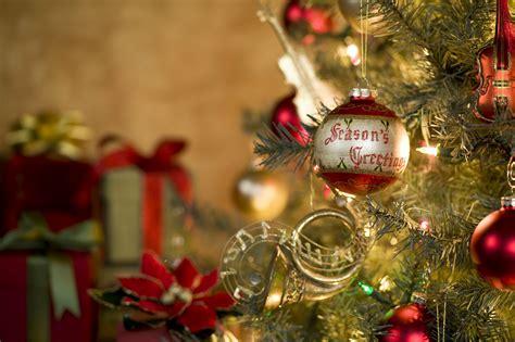 season s greetings ornament on tree kodiak electric