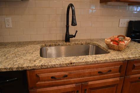 ceramic subway tile kitchen backsplash kitchen subway tile brown cabinets appealing