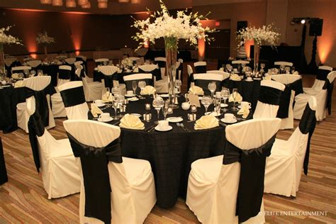 white tablecloths black napkins black chair covers