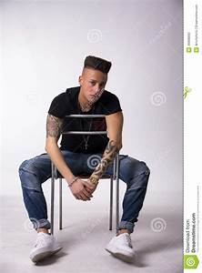 Trendy Tattooed Young Man Sitting On Chair Stock Photo ...