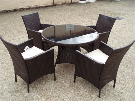 rattan table 4 arm chairs cushions wicker glass