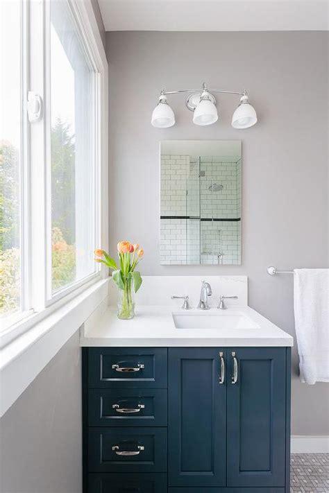 navy bathroom vanity  frameless mirror contemporary