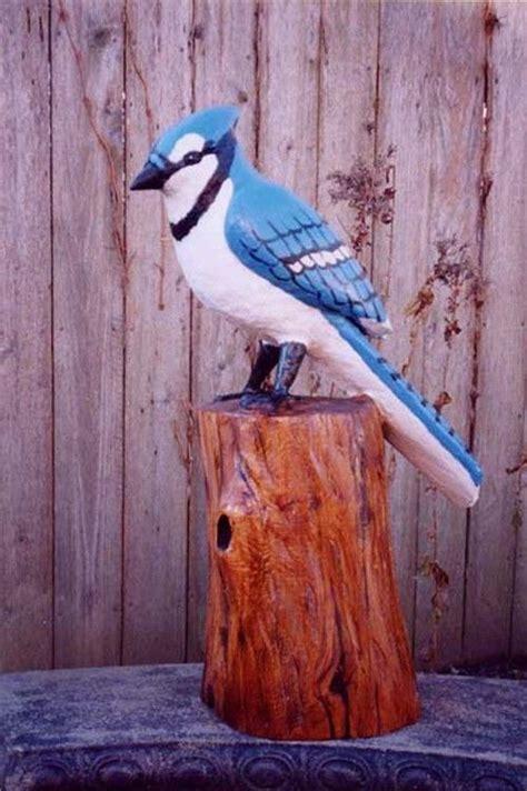 chainsaw sculpture  iowa bluejay blue jays