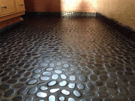 pebble rock shower floor river rock floor in bathroom complete flooring diy