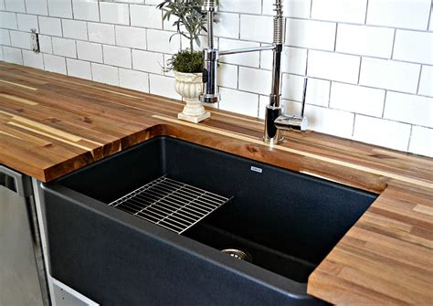 black composite kitchen sink a black farmhouse sink gives our country kitchen a warm feel 4661