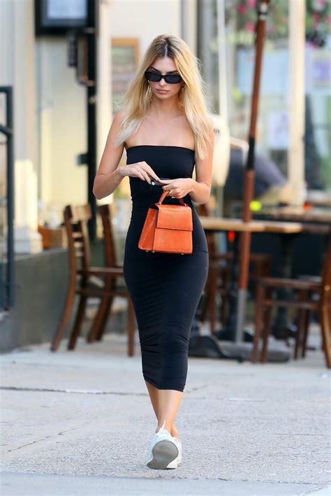 Emily Ratajkowski stuns in a black strapless dress as she ...