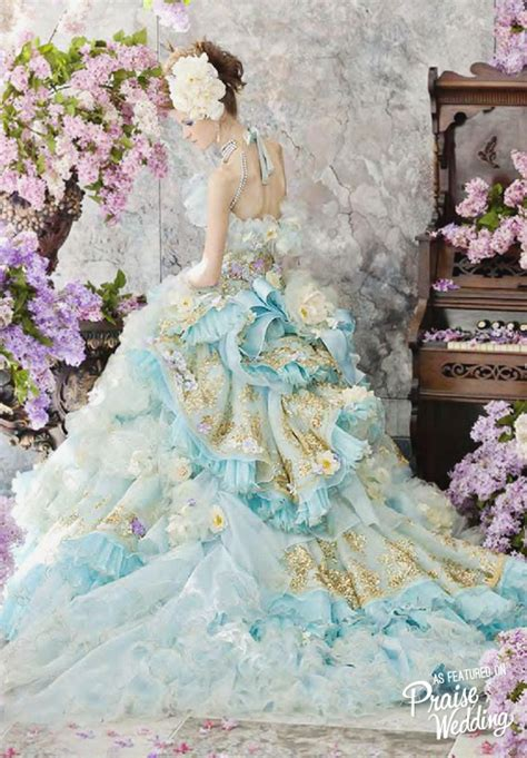 baby blue  gold gown filled  flowers  stella de